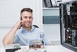 Smiling computer engineer on call by open cpu