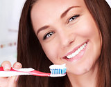 Cute woman clean teeth