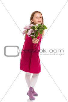 Beautiful young girl with lilac flowers