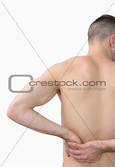 Rear view of shirtless man with backache