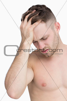 Closeup of man suffering from headache