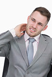 Young business man with neck pain