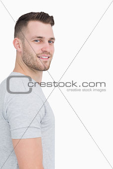 Side view portrait of smiling young man
