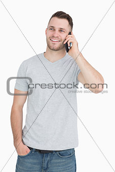 Casual young man using mobile phone
