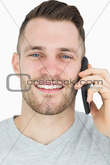Closeup portrait of young man using mobile phone