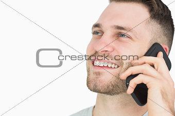 Closeup of young man using mobile phone