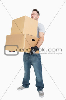 Young man carrying package boxes