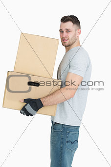 Portrait of tired young man carrying package boxes