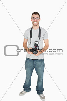 Portrait of male photographer with photographic camera