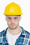 Portrait of architect wearing protective eyewear and hardhat