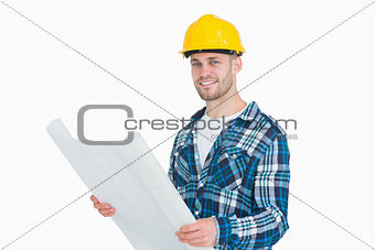 Portrait of smiling young male architect with blueprint