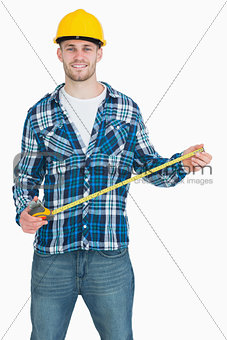 Portrait of smiling male architect with tape measure