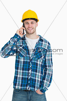 Portrait of young male architect using cellphone