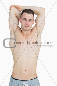 Portrait of bare chested young man posing