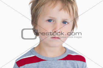 Closeup portrait of cute young boy with blue eyes