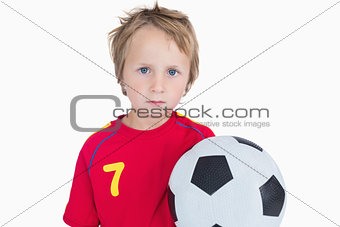 Portrait of young boy with football