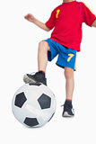 Young boy with foot on soccer ball