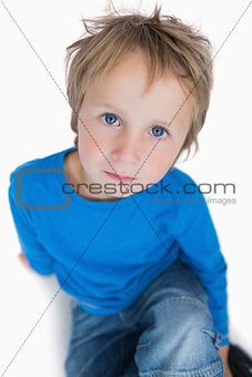 Portrait of cute young boy with blue eyes