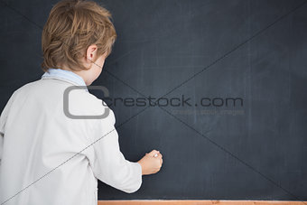 Boy dressed as teacher and writes on black board