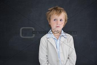 Boy dressed as teacher in front of black board