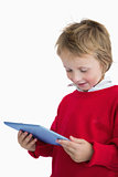 Happy little boy looking at digital tablet
