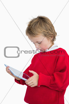 Little boy looking at digital tablet