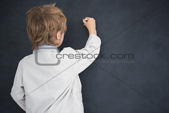 Boy dressed as teacher writes on black board