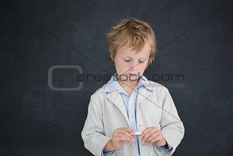 Boy as teacher in front of black board