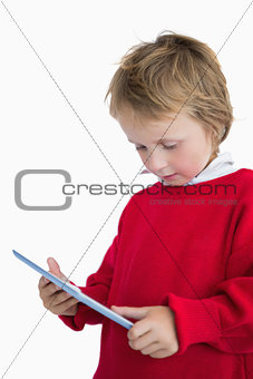 Little boy looking at digital tablet