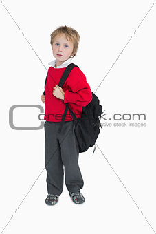 Portrait of young boy with schoolbag