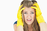 Young upset chore woman wearing yellow cleaning gloves