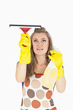 Maid in yellow gloves using wiper and disinfectant spray
