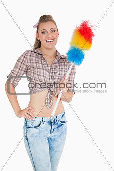 Portrait of casual woman with colorful feather duster
