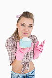 Portrait of woman blowing soap suds over sponge