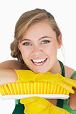 Closeup portrait of cheerful woman with broom