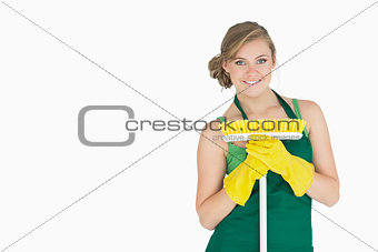 Portrait of young woman with broom