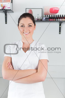 Portrait of confident young woman at nail salon