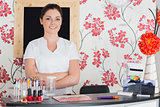 Confident woman at reception in nail salon
