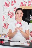 Smiling woman holding nail shades at salon