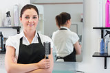 Hairdresser with hair brush in hairdressing salon
