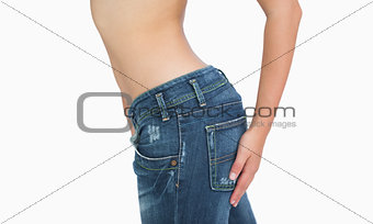 Side midsection of slim woman in jeans