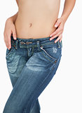 Midsection of slim woman in jeans