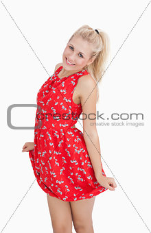 Portrait of young woman in red summer dress