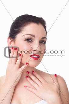Portrait of woman with red lips and red painted finger nails
