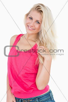Portrait of happy casual young woman with blonde hair