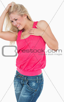 Happy casual woman with blonde hair dancing