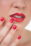Woman red painted finger nails and red lips