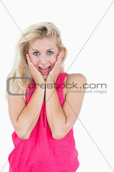 Portrait of happy surprised casual young woman
