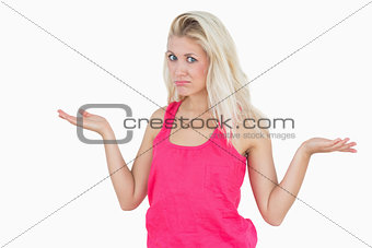 Beautiful young woman gesturing do not know sign