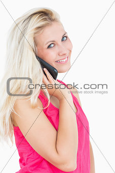 Portrait of happy casual young woman on call